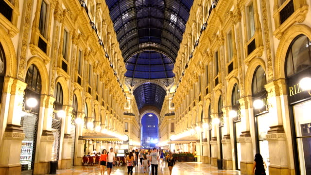 night view of milan vittorio emanuele ii gallery in milan, italy. - museo video stock e b–roll