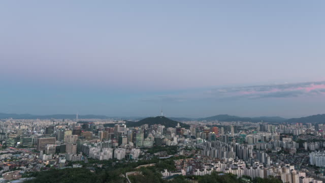 night view of n seoul tower (famous tower for tourist) and city buildings in seoul - straßenschild stock-videos und b-roll-filmmaterial