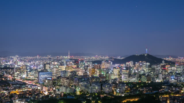 vídeos de stock, filmes e b-roll de night view of n seoul tower (famous tower for tourist) and city buildings in seoul - placa de nome de rua