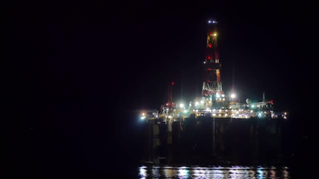 night view of north sea oil rigs in the cromarty firth of easter ross scotland uk the oil platforms are brought into the cromarty firth for refitting... - ross sea stock videos & royalty-free footage