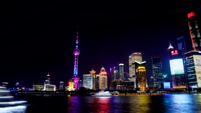 night view of oriental pearl tower and swfc with skyscrapers on the huangpu river in shanghai, china - shanghai stock videos & royalty-free footage