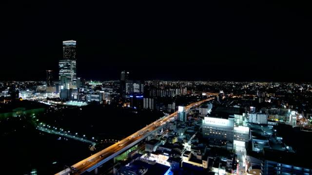 nachtansicht von osaka stadtansichten von umeda sky building in japan. - präfektur osaka stock-videos und b-roll-filmmaterial