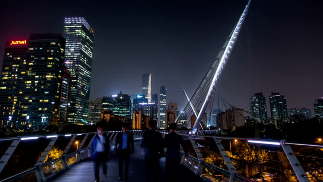 Night view of people strolling at Saetgangdari bridge in Yeouido Business District