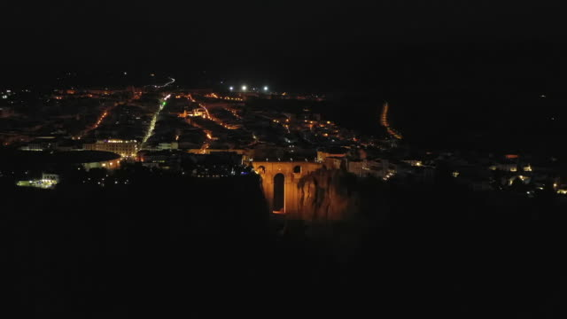 night view of puente nuevo and nearby area / ronda, spain - puente video stock e b–roll