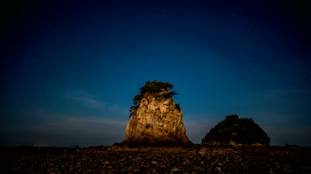 night view of rocks on kkotji beach in taean-gun - tide stock videos & royalty-free footage