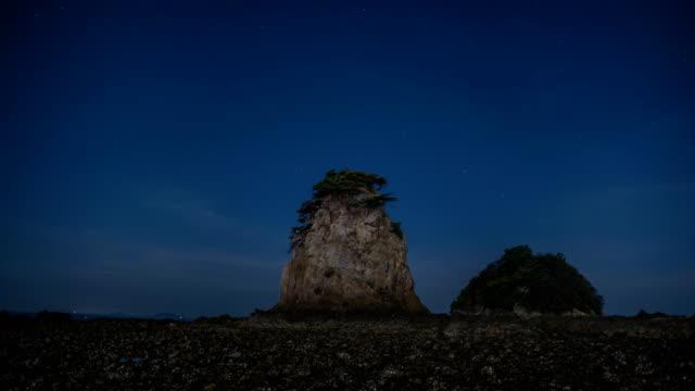 stockvideo's en b-roll-footage met night view of rocks on kkotji beach in taean-gun - kei