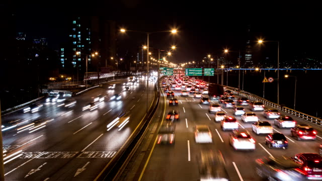 night view of rush hour in gangbyeonbungno (hangang riverside expressway) - headlight stock videos and b-roll footage