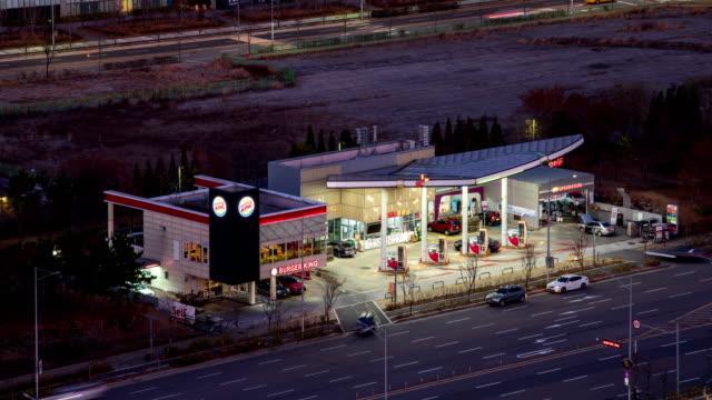 night view of self-service gas station / songdo-dong, yeonsu-gu, incheon, south korea - stazione di rifornimento video stock e b–roll