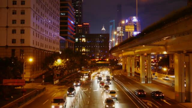 night view of shanghai city,china - 乗り物の明かり点の映像素材/bロール