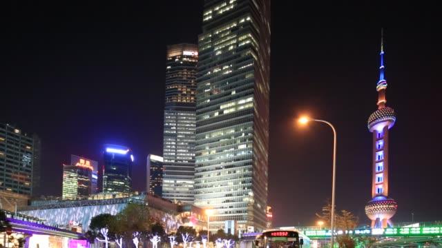night view of  shanghai landmark building, china, construction and traffic light trails - 尖り屋根点の映像素材/bロール