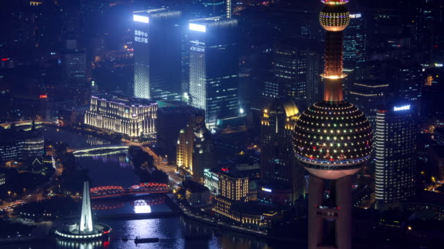 night view of shanghai monument to people's heroes by huangpu river in shanghai, china - river huangpu stock videos & royalty-free footage