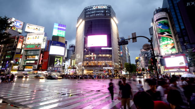 Night view of Shibuya Pedestrian Scramble crossing and downtown on cloudy day in Tokyo, Japan