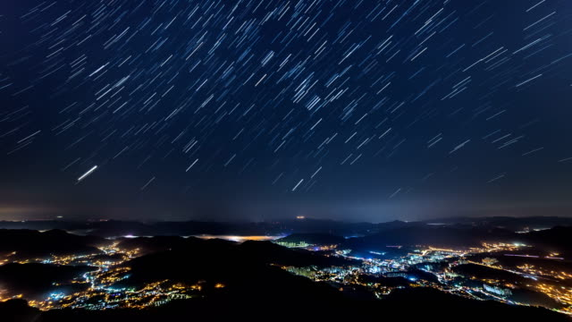 night view of star trail and cityscape at cheonmasan mountain (officially designated as a provincial park in korea) in gyeonggi-do - star trail stock videos & royalty-free footage
