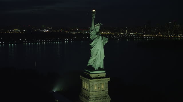WS AERIAL ZI Night view of Statue of Liberty