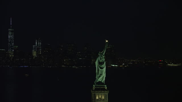 WS AERIAL ZO Night view of Statue of Liberty