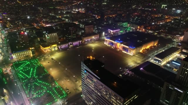 night view of sukhbaatar square and cityscape in ulan bator, mongolia - piazza video stock e b–roll