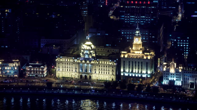 night view of the clock tower and city buildings on the huangpu river in the bund(waitan) area, shanghai, china - the bund stock videos & royalty-free footage