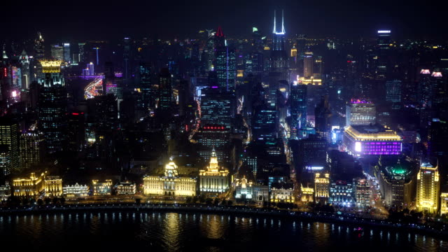 night view of the clock tower and city buildings on the huangpu river in the bund(waitan) area, shanghai, china - wide stock-videos und b-roll-filmmaterial