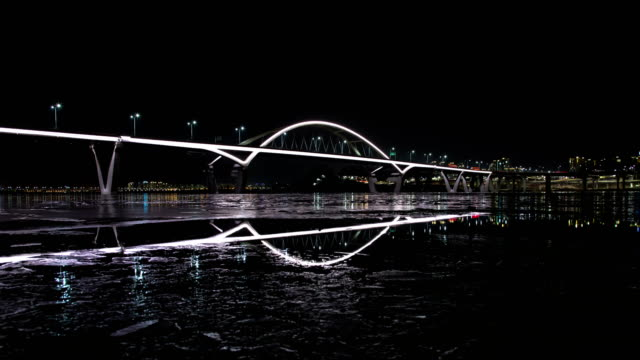 night view of the guri amsa bridge (over the han river) in guri, gyeonggi-do province - kyonggi do province stock videos and b-roll footage