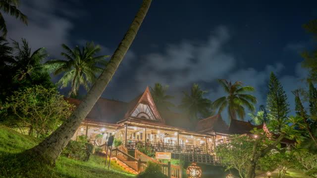vidéos et rushes de night view of the resort in the palms, phuket, thailand - arbre tropical