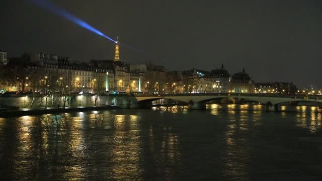night view of the river seine, in the background the lighthouse of the eiffel tower lights up the city sky on january 7, 2021 in paris, france.... - atmospheric mood stock videos & royalty-free footage