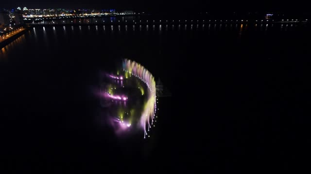 night view of the waterfall show on the sea in mokpo - luminosità video stock e b–roll