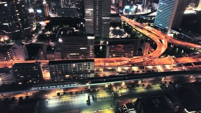 night view of tokyo with multiple lane highway - motorway stock videos & royalty-free footage
