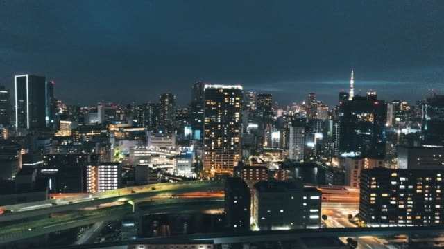 night view of tokyo with multiple lane highway - office block exterior点の映像素材/bロール