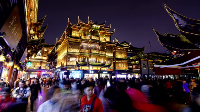 Night view of tourists on Yu Yuan Gardens in Shanghai, China