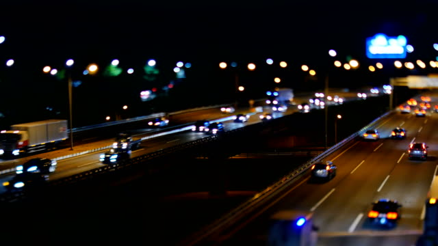 Night view of traffic moving on Ollimpikdaero road