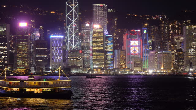 stockvideo's en b-roll-footage met nacht uitzicht op victoria harbour - star ferry