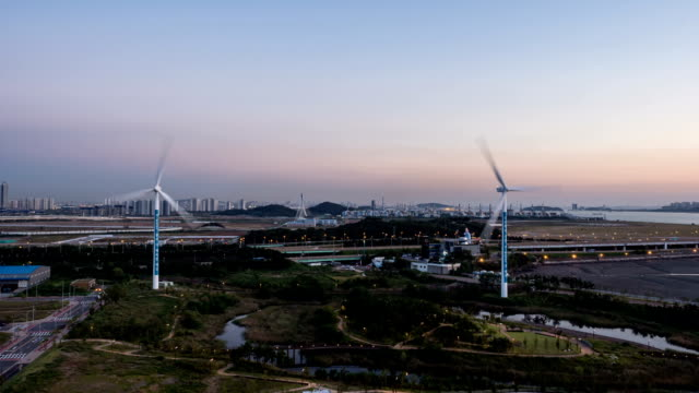 stockvideo's en b-roll-footage met night view of wind turbine area and cityscape in incheon - incheon