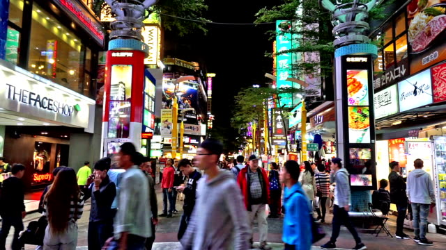 night view of young customers wander at ximending shopping street, taipei, china - taipei stock videos & royalty-free footage