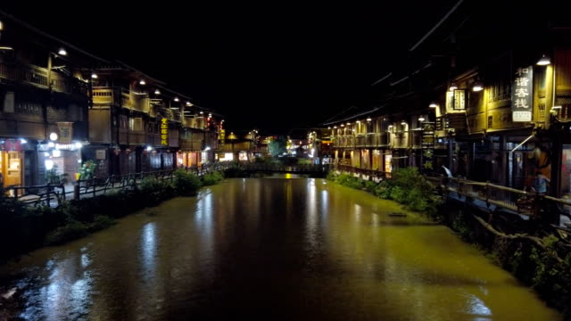 night view of zhaoxing dong village, guizhou, china - town stock videos & royalty-free footage