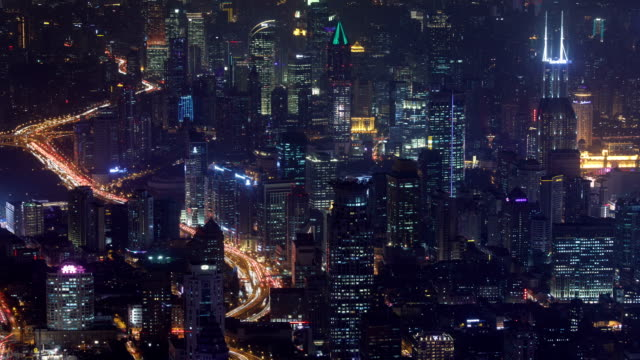 night view with skyscrapers from swfc tower observatory in shanghai, china - 離れた点の映像素材/bロール