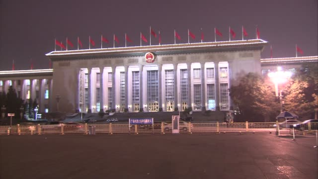 beijing tiananmen square good shot of the great hall of the people lit up with traffic and people occassionally in foreground / people walking in... - tiananmen gate of heavenly peace stock videos & royalty-free footage