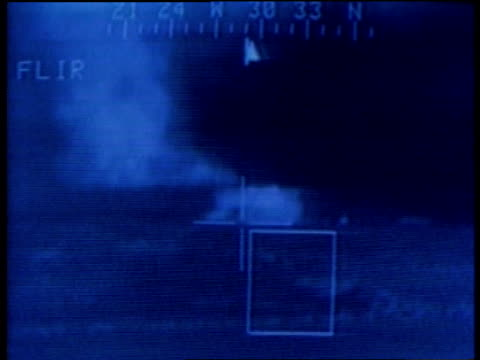 Night vision crosshairs targeting a bunker and target exploding / Kuwait