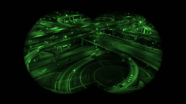night vision green colour, the highway in the big city, expressway enter the city, night light picture by drone on top view. - night vision stock videos and b-roll footage