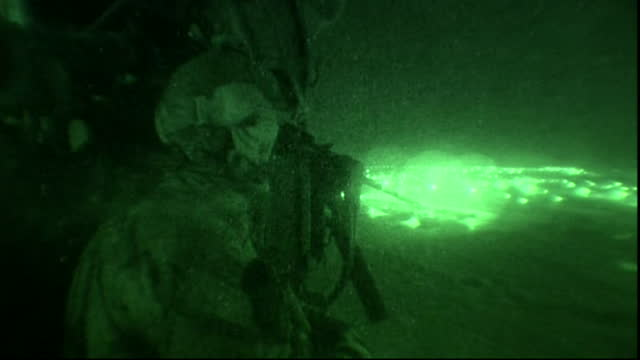 night vision of us army soldiers shooting rounds from helicopter in afghanistan - afghan national army stock videos & royalty-free footage