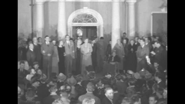 VS President Franklin Roosevelt stands in group outside front door of Springwood with his sons Franklin Jr John their wives his wife Eleanor his...