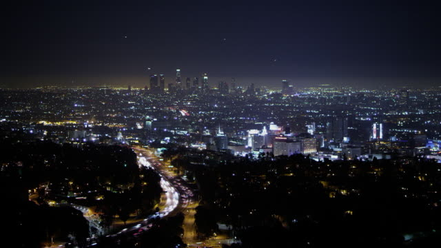 Night, wide angle, timelapse, Hollywood and 101 freeway in foreground, downtown Los Angeles in distance
