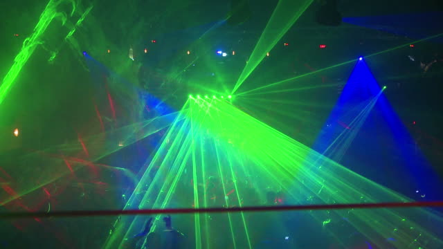 nightclub crowd with laser lights - nightclub stock videos & royalty-free footage