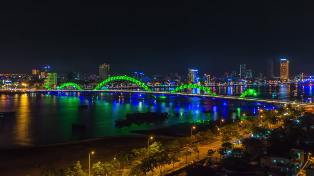 nightfall in danang ending with fireworks looking at dragon bridge. danang, central vietnam, asia - ダナン点の映像素材/bロール