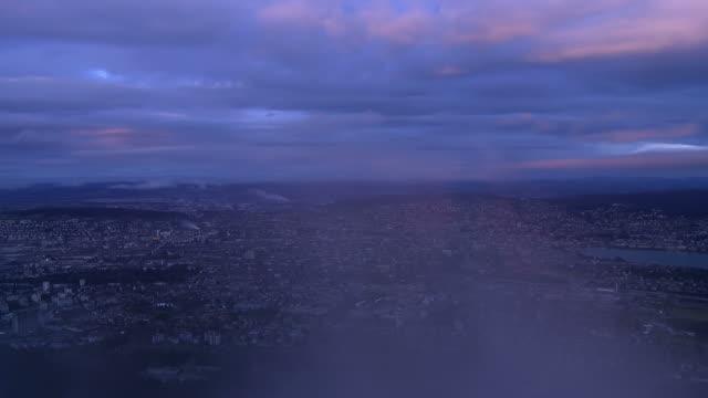 nightfall over city, lights turned on