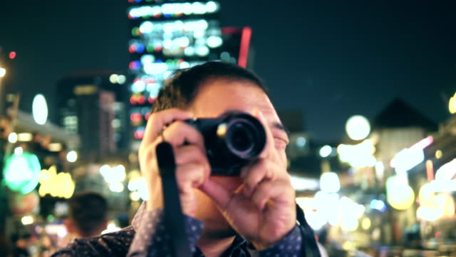 nightlife :  young asian man capturing images - pattaya stock videos & royalty-free footage
