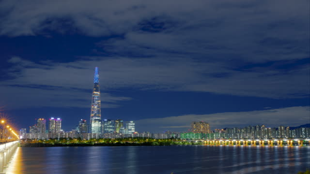 nightscape with lotte world tower and jamsildaegyo bridge at han river / jamsil-dong, songpa-gu, seoul, south korea - tower stock videos & royalty-free footage