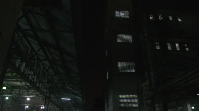 nighttime darkness envelops a mumbai railway station and neighbouring building, maharashtra, india. - fluorescent stock videos & royalty-free footage