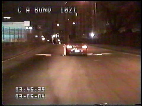 / nighttime dashcam of police car chasing suspect / driver bails out of car and falls into street. police chase ends when suspect bails out of car on... - wreck stock videos & royalty-free footage