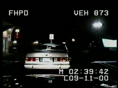 / Nighttime dashcam / police following car as car turns woman hangs out passenger seat waving to cops / car stops and police officer approaches drunk...