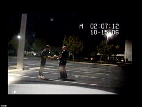 vídeos y material grabado en eventos de stock de / nighttime dashcam video drunk man helping officer lay down a measuring tape / man falls face first onto the pavement drunk man smashes face on... - cinta métrica